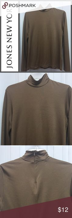 Jones New York Long Sleeve Mock Turtle Neck Beautiful and stylish. Long sleeve  mock turtleneck with back zip up neck. Light brown in color. Size is L, 70% Rayon,30% Poly. EUC. Check out other items in my closet to bundle and save. Reasonable offers accepted. Jones New York Tops