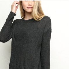 BNWT dark gray Wendy sweater BNWT. Looks black in first & second pics but is actually dark gray like the last pic. Is the slightest bit see through but only if you wear a very bright colored bra. Brandy Melville Sweaters