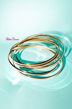 Jingle all the way. Paloma's Melody five-band bangles in 18k gold and sterling silver.