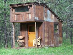 Tiny house made with reclaimed materials. More photos on the site.