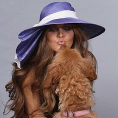 Photo session for some new hats...our model Staci was getting to know Sophie, our adorable labradoodle