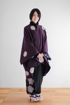 """Wool poncho, featuring """"Shibori"""" Japanese traditional tie dye by Kyoto local artisan, Kazuki Tabata. Each piece is hand dyed at his studio in Kyoto, Japan. Available on sousouus.com"""