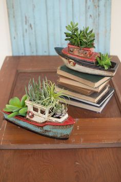 """Ceramic Boat Planter Boat planters made of Ceramic vivid distressed colors and a glossy coat glaze. Small : 2 hole planter, white bottom and red top. Medium : 3 Hole planter, turquoise bottom, and white top. Measurements: Small : 13"""" long x 5"""" wide x 5""""1/2"""" tall Medium : 14"""" long x 6"""" tall x 4"""" wide"""