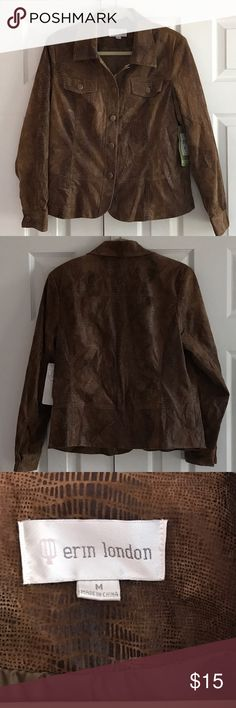Erin London faux snake patterned jacket 73% polyester 24% rayon 3% cotton and wash cold or dryclean.  Jacket buttons up the front and each cuff buttons. Jacket is fully lined. NWT and extra button.  Color is a golden medium brown with darker snake skin design. Erin London Jackets & Coats Blazers