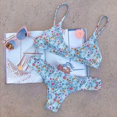 All the flowers - of all the tomorrows - are in the seeds of today. Flourish in Gigi's pastel mint based & daisy field Kini.
