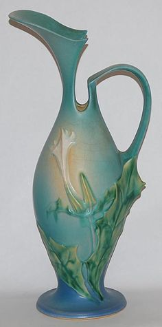 Roseville Pottery Thornapple blue ewer. ---my Dad grew up in Roseville and always told me about how gorgeous this pottery was. I just decided to look it up and wow!