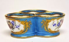 Salt cellers, c.1770 Soft-paste porcelain, coloured enamels and gilt French, Sevres Mark: crossed L's for Sevres Width: 10.43 cm.