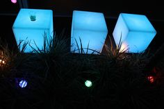 Illuminated cubes.                  AND coloured Pool lights - 100 of them scattered everywhere - on furniture, windows, garden beds, walls