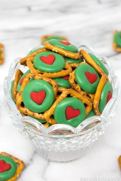 holiday treats Grinch Pretzel Bites crunchy pretzel snaps, festive green chocolate wafers, and a delightful red heart quin; a sweet and salty holiday treat that even a Grinch will love. Grinch Party, Grinch Christmas Party, Easy Christmas Treats, Christmas Goodies, Christmas Candy, Christmas Baking, Holiday Treats, Simple Christmas, Christmas Classroom Treats