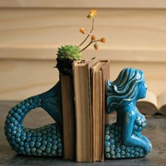 The mythical – or maybe not – mermaid adapts to dry land while holding a stack of books in place. She's more than just a fish tale. Highly detailed and finished in a, what else, watery blue. brbr...