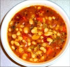 Bean and Ham Soup Recipe   Great Northern Beans with sage, savory, thyme, carrots, celery & onion with tomatoes added along with low-sodium chicken broth.
