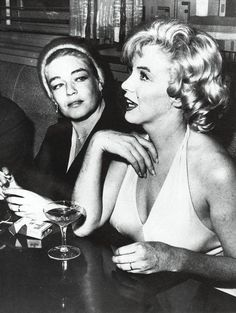"""Marilyn Monroe and Simone Signoret at a press party for """"Let's Make Love"""", January 16th 1960."""
