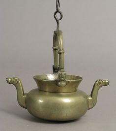 Laver  Date: probably 15th century Culture: Netherlandish Medium: Brass, with iron swivel and suspension loops Dimensions: Overall (with handle up): 12 5/16 x 10 15/16 x 6 5/8 in. (31.3 x 27.8 x 16.9 cm) Overall (vessel only): 5 1/2 x 10 15/16 x 3/4 in. (13.9 x 27.8 x 1.9 cm)