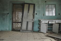 Boston GA Abandoned Farmhouse Blue kitchen Screen Door Falling Cabinets Drawers Abandoned Rural Southern Decay Pictures Photo Copyright Brian Brown Vanishing South Georgia