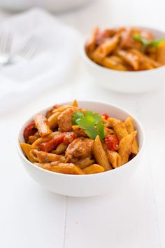 Puerto Rican Chicken Pasta: juicy bites of chicken, sautéed peppers and onions, and penne pasta to soak up a delicious sofrito-based broth!   Kitchen Gidget