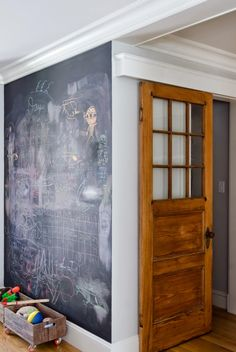 love the chalkboard and conventional door on roller track!   Olson Lewis Architects + Kristina Crestin Design
