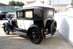 Early 1900s.  The LADP purchased their first police car in 1907.