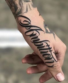 Title Hand Tattoos Names will be designed with letters alone or together with footage and decorations. The tattoo lettering displays … Bild Tattoos, Dope Tattoos, Badass Tattoos, Body Art Tattoos, Small Tattoos, Sleeve Tattoos, Thigh Tattoos, Side Hand Tattoos, Hand Tattoos For Guys
