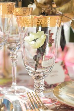 Small Floral Arrangement Inside Glass with Gold Detaling | Photography: Thisbe Grace Photography. Read More: http://www.insideweddings.com/weddings/dramatic-wedding-shoot-inspired-by-alexander-mcqueen-chanel/749/