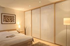 DOORS DIRECT Monaco | Sliding Wardrobe Doors | polar white glass panels with pearwood effect frame