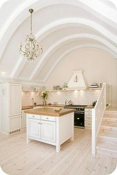 white kitchen with stairs