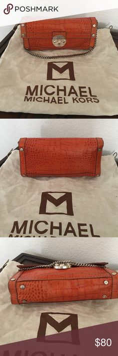 Amazing Micheal Kors Purse Gorgeous orange leather Micheal Kors Purse. It has a beautiful chain handle. Small enough to use as a bigger clutch but big enough to put over your shoulder. 💯 percent Authentic comes with dust bag. Used the person for maybe a week then it has sat in my closet, so it can use some shaping and some tender love ❤️!!! Open to all offers and trades, trades will be a little bit higher... MICHAEL Michael Kors Bags Satchels