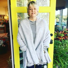 Kathy has the best Christmas gift pick for the travelers on your list! This cozy travel shawl is perfect for airplanes and road trips. Just what you need during chilly winter months! Shop for it now on our website! #tfssi #stsimons #seaisland #Christmas2015 #holidayshopping #tfgirlsfavoritethings