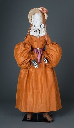 """Circa 1836-1837 apricot silk taffeta day dress, Europe. """"The extreme breadth of the sleeves represents the last vestige of the 'imbecile' style."""" Via FIDM."""