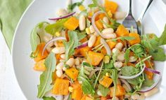 Butternut Squash and Arugula Salad with shaved red onion, white beans, and a tangy balsamic vinaigrette. This is such a simple, easy, and HEALTHY salad!