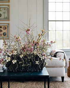 coffee table centerpiece made of flowering branches