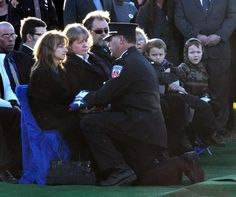 Brian Gillett, Washington Township Fire Chief, gave Janet Haudenschild the flag from her husband's casket Saturday afternoon at his graveside burial.(Photo by Ellie Bogue of the News-Sentinel). 11-17-2012