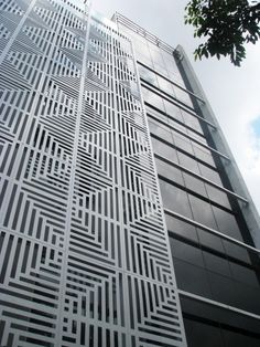 Islamic lattice works have been modernized into modular aluminum screen walls, giving the building a language through which the exterior and the interior could be addressed.