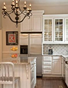 Love the grey tiled backsplash turned to a diamond pattern! White and grey such a calming affect!
