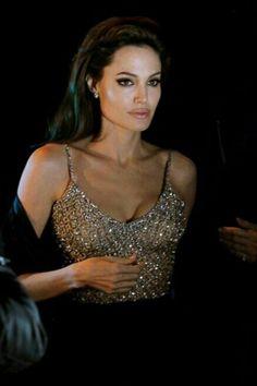 Angelina Jolie - love the look: dark eyes, pink lips, gold top... Beautiful