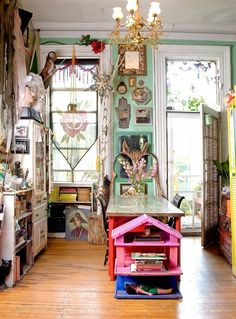A small space does not have to be boring. Check out these tall skinny windows, the unusual chandelier, and bright colors here. | Dishfunctional Designs: The Bohemian Kitchen | Tiny Homes