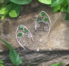 Elf Ear Cuffs: Lothlórien.    Wire is silver plated copper with silver plated copper wire wrap. There is a scrolly design made of silver plated
