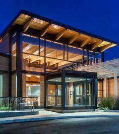 The Marlborough Hospital Cancer Pavilion entrance at night, with lighting showcasing the interior and exterior wood finishes. Photo: © John Giammatteo.