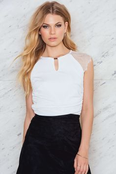 You're an attention keeper! The Nuby top is made in cream white silky material and features stretch fabric, lace details, ruched details and is fully lined. Pair it with skinny high waist jeans and alarming heels!