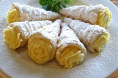 """There is an Italian pastry called """"cannoncini"""", which means """"little cannons"""". These are a bit like cannoli, but filled with pastry cream instead of ricotta cheese. Italian Pastries, Italian Desserts, Italian Recipes, Lemon Desserts, Gourmet Desserts, French Pastries, Delicious Desserts, Dessert Cannoli, Tiramisu"""
