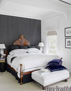 "In the master bedroom, Ralph Lauren Home's Sloane Stripe wallpaper ""provides relief from the heavily ornamented bed,"" Fulk says."