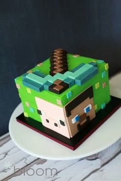Looking to make a Minecraft cake? These 25 different Minecraft birthday cake ideas will give you plenty of inspiration, from easy to make frosted cubes to elaborate world scenes. Minecraft Torte, Minecraft Birthday Cake, Easy Minecraft Cake, Minecraft Cupcakes, Minecraft Crafts, Minecraft Ideas, Minecraft Skins, Fondant Cakes, Cupcake Cakes