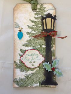 Christmas altered tag using Tim Holtz Sizzix dies and Webster's Pages paper. We also added Diamond Dust to give a pretty sparkle look to the tree.