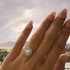 The 1 ctw double halo oval ring with a 3/4 carat center stone The ring with a band is on sale now at ✨ TigerGems.com for $149.99