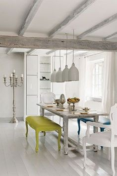 painted floors, several pendants, mix of benches and chairs