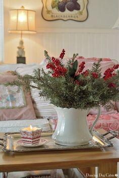 Pine boughs in vintage ironstone pitcher with red berries, vintage pillow fabric, red and white candle - subtle Christmas ♥