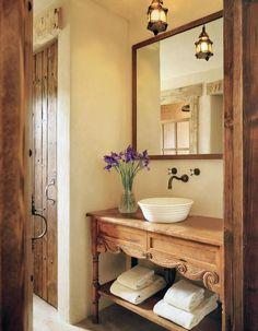 Charming Cottage Chic Bathroom with Elegantly carved wood vanity