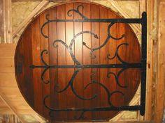 Because What kind of fan would I be if I custom built a home and didn't add a hobbit door? Door Knockers, Door Knobs, Door Hinges, Round Door, Cool Doors, House Doors, Fairy Doors, Iron Work, How To Antique Wood