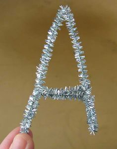 Pipe Cleaner Letters for packaging! - @Mary Powers Powers Pinkert - cheap Christmas wrapping?