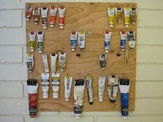 oil paint hanging display and storage with binder clips