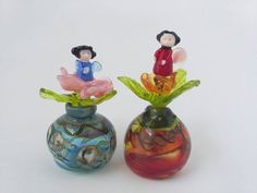 Check out this item in my Etsy shop https://www.etsy.com/uk/listing/484193279/hand-blown-miniature-perfume-bottles-by